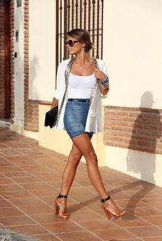 jean skirt, white tank, sweater, and heels