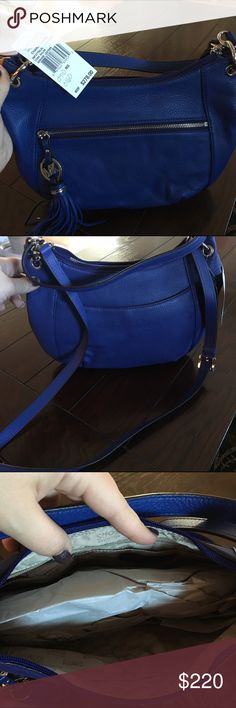 Michael Kors Purse Cobolt Blue leather Michael Kors Purse. Silver embellishments. Authentic. Brand new, never been used, still with tags. Michael Kors Bags Shoulder Bags