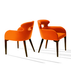 Comfy Chair designed by Stanley Jay Friedman. These stylized chairs are very comfortable with form fitting contours and uniquely shaped wooden legs. The Comfy Chair has a classical but modern appeal.