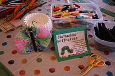 station 3 was clothespin butterflies. kiddos colored a coffee filter using markers (watercolors are way prettier, but i wasn't bringing that mess into the mix) and then put it inside a spray-painted clothespin. add a pipe cleaner antennae & voila! butterfly.
