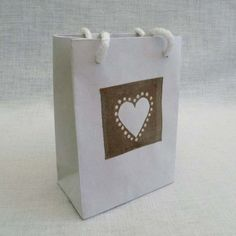 Paper carrier bag decorated with a hand painted /crafted recycled tea bag.