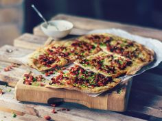 The tart flambée is incredibly tasty and can be prepared with a variety of toppings.