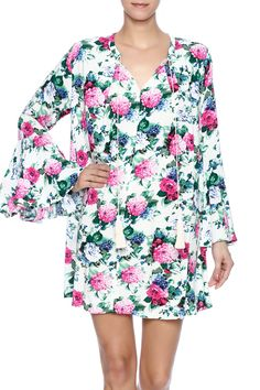 Floral printed dress with a v-neckline, long bell sleeves, tassel ties and a pleated back.   Floral Dress by Umgee USA. Clothing - Dresses - Casual Clothing - Dresses - Floral Clothing - Dresses - Long Sleeve Tennessee