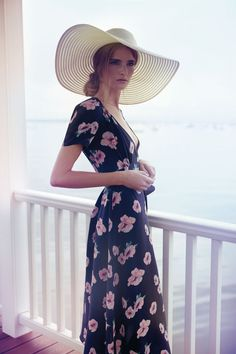 70s inspired full length summer floral dress with floppy sun hat