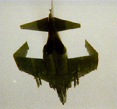 F-4 flying with folded wings