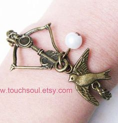 The Hunger Games Inspired Katniss Bow with Mockingjay and Peeta Pearl Bracelet
