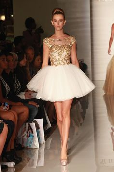 Ornate gold embellishments beautifully juxtapose frothy white tulle.
