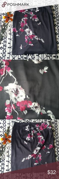 Black Floral Skirt Skirt is in great condition now flaws. the material is very smooth and true to size. the color is virbrant.  full length- 24 1/2in  width-21in White House Black Market Skirts