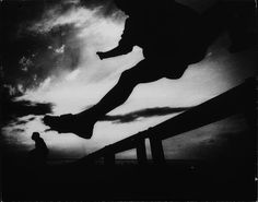 Photographer/Creator  Lowell Georgia  Collection  1962  Publisher  Denver Post  Caption/Description  Shadow of a hurdler jumping over a hurdle.