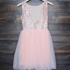 Beautiful dazzling rose sequins adorn this ballerina style tulle bottom peach base dress. A darling dress for any special occasion. Perfect for prom, homecoming