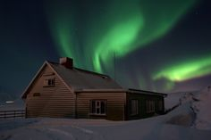 Watching the Northern Lights flashing across the sky in brilliant patterns