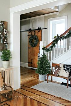 transition from Christmas to winter decor - love this farmhouse inspired fixer upper hallway and barn door