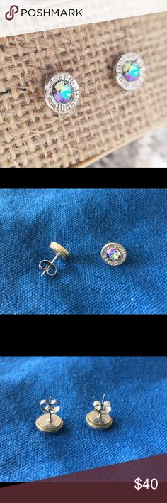 "Bullet Earrings w/ Swarovski Paradise Gemstone. Recycled fired 9mm rounds nicely shined up & paired with Swarovski gemstones. Nickle plated. Made by Shinelife.   Approx 1/3"" ish in diameter.   Purchased these custom earrings not long after getting my ears pierced because I love the stone. The stone reminds me of a light alexandrite (true alexandrite, not ""light purple"") — which is my expensive birthstone. After ordering realized not my style & I prefer tiny earrings.  I wore these once for a…"