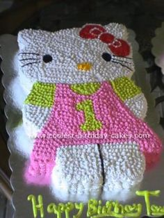 Hello Kitty Cake: I baked this Hello Kitty cake for my next door neighbor. For  the frosting I used the buttercream recipe and tips #16 and 18.  It was fun to decorate it...