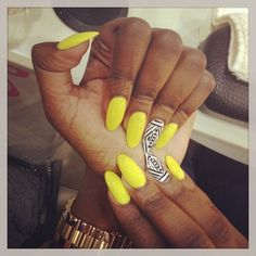 Yellow with black and white tribal accent nail