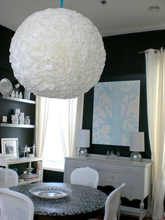 Seriously want to make this.  Coffee filters glued to a massive paper lantern.