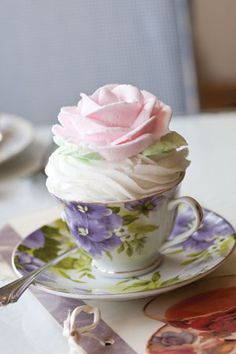 Gorgeous small cake in a teacup.