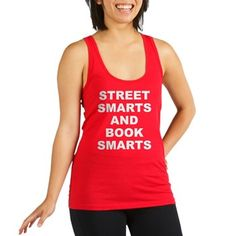 Women's dark color poppy red racerback tank top with Street Smarts And Book Smarts theme. In most cases the average person either has street smarts or book smarts. When someone has both they have an advantage in society. Available in black, navy blue, teal green, poppy red; x-small, small, medium, large for only $22.99. Go to the link to purchase the product and to see other options – http://www.cafepress.com/stsmarts