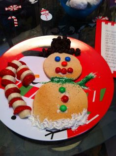 Christmas breakfast- snowman pancakes & strawberry-banana candy cane