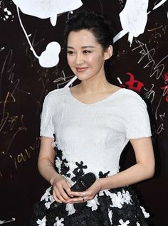 Actress Xu Qing attends the premiere of Mr. Six in Beijing.  http://www.chinaentertainmentnews.com/2015/12/star-studded-premiere-of-mr-six.html