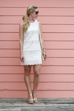 white lace shift dress, coral earrings, gold wedge sandals
