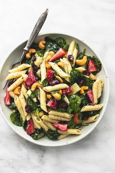 Sweet and tangy strawberry spinach pasta salad with orange poppyseed dressing is the perfect potluck side dish for every get together.