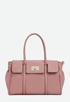 cf2575185ebb A faux leather bag with a turn-lock closure and adjustable shoulder strap.  Perfect