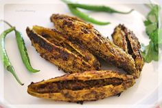 How to make Stuffed Karela, Bitter gourd stuffed with fresh indian spices. Traditional Punjab Style Karela Recipe, Step by Step Stuffed Karela Recipe… Continue reading → Veg Recipes, Indian Food Recipes, Vegetarian Recipes, Dessert Recipes, Cooking Recipes, Ethnic Recipes, Desserts, Bitter Melon, Kitchens