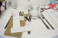 Instead of table numbers, use letters to spell out last name. Have a sharpie at each table & let the guests write notes on the back of them. Perfect house art afterwards!