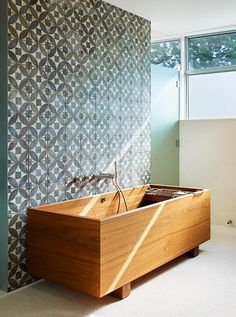 A wooden bath tub and some great tile.