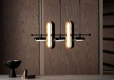 circuit + tassle lamps by apparatus blend contemporary and classic aesthetics