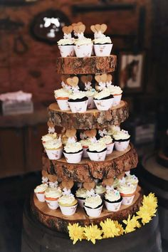 Rustic wood cake stand with cupcakes for dessert table