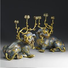 A good pair of cloisonné Fu-lion candelabras. Qing dynasty, 18th century.