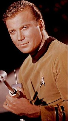 William Shatner as James T Kirk, I want to actually MEET him, not just ask him a question at a convention. He is a fascinating person! I have been a fan for almost 40 years. That is saying a lot since I am just 46.
