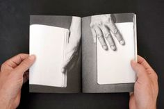 "hands hold book, turn page, reveal hands - what look like image but then turn real and take control over the book, it spins and a power struggle over which reality is ""real"" takes place. text can be educational, information on schzophrenia, mutants, images of unrest or to contrast the struggle, very peaceful images. maybe when the hands within the book take over the peaceful images become distorted/fucked up"