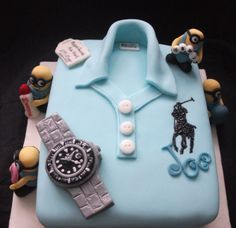 My latest cake made for my daughters boyfriend.  Ralph Lauren polo shirt with minions. and some of his favourite things..football, bingo and watches.