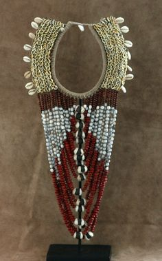 West Papua New Guinea | Vintage necklace; shells seeds, wood and natural fiber | 320$ including custom stand.