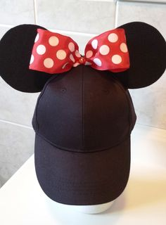 PLEASE READ ENTIRE LISTING - SEE TIME FRAME & SHIPPING INFO BELOW  :::ORIGINAL - Ear-perfection stay up ears! These ears do not sag, wilt or flop on or off your head!! Made using my Ear-perfection construction method - yes, you can put them in your back-pack too! :::  Minnie Mouse inspired Ears with Big Red Polka Dot bow on a black adjustable baseball cap style hat. (Small/Med – fits most) with ponytail opening. Go styling through the parks or anytime you need shade from the hot sun!...