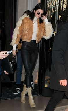 Perfect in Paris! The model is seen out and about in leather pants and a fur coat.