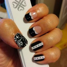 My Black Tie manicure using Jamberry Nail wraps in Black Floral, Black Tie Affair, and Madeline.  Makes me think of Downton Abbey!  Buy them here: http://nhough1973.jamberrynails.net