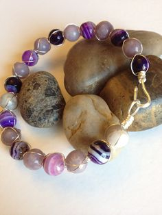 Lilac stone and purple striped agate wire wrapped in silver artistic wire.  $15.00