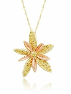 """10k Yellow and Rose Gold Flower Yellow Diamond Pendant Necklace (1/5 cttw), 18"""" Amazon Curated Collection. $253.00. Made in China. The total diamond carat weight listed is approximate. Variances may be up to .03 carats.. All our diamond suppliers certify that to their best knowledge their diamonds are not conflict diamonds.. Save 49% Off!"""