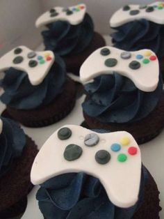 Xbox cupcakes.  There doesn't seem to be directions, but I would assume you could replicate this with fondant icing.