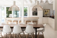 Victo 4250 pendants by Secto Design create a welcoming dining area together with the Vitra chairs. Home | Kim & Koen