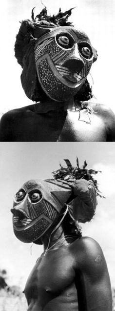 Africa | Bopende Tribesman of Western Congo Wearing Mask During Boys Initiation Ceremony | Photographer Eliot Elisofon.  ca. 1960