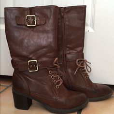 Brown boots Brown leather boots that lace up in the front. There is a zipper on the inside and buckles on the outside. Shoes Combat & Moto Boots