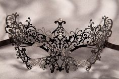 Google Image Result for http://www.justposhmasks.com/uploads/products/black_metal_masquerade_masks_RICCIOLINA320.jpg