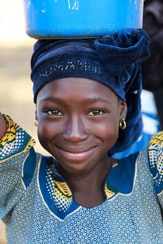 Africa | Smiling girl photographed in Niger.    Many girls in Niger have the first letter of their name tattooed on their forehead. | ©Ferdinand Reus
