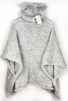 Cuddly knitted poncho for winter with a high collar / knitted cape for . Cuddly knitted poncho for winter with a high collar / knitted cape for the winter season, knitwear made by Alexandra Mil. Poncho Pullover, Poncho Sweater, Baby Cardigan, Diy Tricot Crochet, Crochet Poncho, Knitted Cape, Cozy Knit, Warm Sweaters, Knitting Sweaters