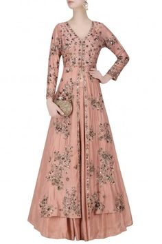 Astha Narang a dark dead rose front open jacket in raw silk with antique floral handwork bootis on front and back. It comes along with a matching dark rose flare skirt in silk.